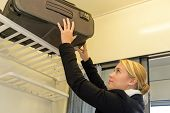 Woman putting her luggage on train rack commuter travel passenger