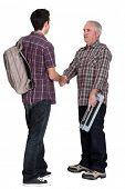 foto of school-leaver  - Experienced tradesman welcoming his new apprentice - JPG