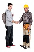 Experienced tradesman meeting new apprentice