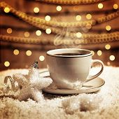 Photo of luxury white cup with tasty coffee, Christmastime table setting, tea mug on brown glowing b