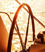 Image of sailboat helm on sunset, steering wheel of yacht, rudder of vessel on sunrise, sea transpor