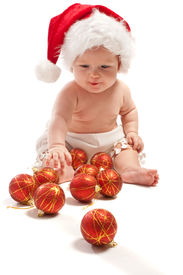 stock photo of new years baby  - Baby in Santa hat playing with Christmas balls isolated - JPG