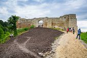 KAZIMIERZ DOLNY, POLAND - JUL 14: Unidentified people walking at the castle ruins in Kazimierz Dolny on 14 of July 2013. This 14th century castle was built by Casimir III the Great, the king of Poland