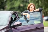 Laughing Happy Woman Standing Near New Car With Keys In Hand