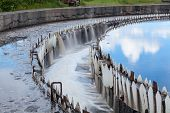stock photo of groundwater  - Water cleaning in settlers at wastewater treatment plant - JPG