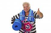 Female Senior With Blue Gym Mat