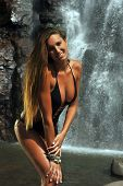 pic of one piece swimsuit  - Long hair sporty girl wearing black one piece swimsuit posing in front of waterfalls - JPG