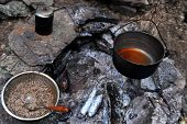 Campfire place with teapot coffeepot and ready to eat buckwheat