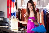 Happy woman paying with credit card