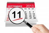 911 Never Forget Concept. 11 September 2013 Calendar With Magnifier