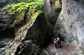 Tourist in the Occidental Carpathians, Radesei Cave, Romania