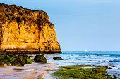 White Yacht At Porto De Mos Beach In Lagos, Algarve, Portugal