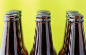 Empty Beer Bottles In Front Of Green