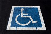 Handicapped Symbol Painted On Ashpalt