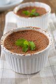 Chocolate flan in a ramekin closeup
