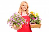 Middle aged female florist holding flowers isolated on white background