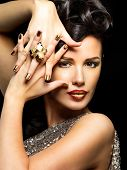 Beautiful Woman With Golden Nails And Style Makeup