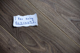 foto of sarcastic  - I like being sarcastic messagewritten on piece of paper on a wood background - JPG