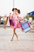 Amazing Girl Walking In The Street With Shopping Bags
