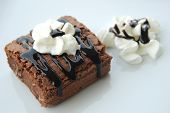chocolate brownie cake with chocolate syrup topping