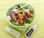 mixed salad with slice grapes carrot, arugula,maize and green salad