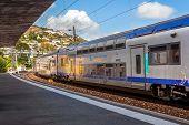 MENTON, FRANCE - JULY 07, 2012: SNCF Ter train departs from station of Menton - popular resort on Fr