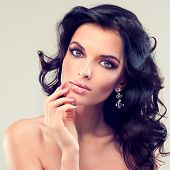 picture of perm  - Model with purple makeup and curled hair - JPG