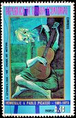 GUINEA - CIRCA 1973: A stamp printed in GUINEA shows guitarist, circa 1973