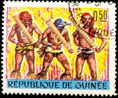 GUINEA - CIRCA 1970s: A stamp printed in GUINEA shows African men playing traditional musical instr