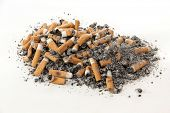Cigarette butts and ashes on a white background