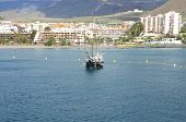 stock photo of tourist-spot  - Hotels and Apartments and the marina of Los Cristianos on Tenerife. Los Cristianos is a tourist spot in the south of Tenerife