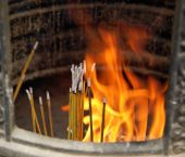 Burning Incense Sticks In Buddhist Monastery In Hong Kong