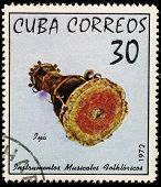 CUBA - CIRCA 1972: A stamp printed in Cuba shows a drum, this is one stamp from a series devoted to folk musical instruments, circa 1972