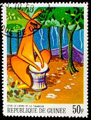 GUINEA - CIRCA 1968: A stamp printed in Guinea shows a kangaroo playing on an african musical instru