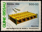 GUINEA - CIRCA 1989: A stamp printed in GUINEA shows Traditional Musical Instruments(balafon ), circ