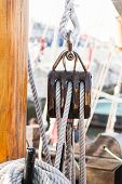 picture of pulley  - Pulley for sails and ropes made from wood on an old sail boat - JPG