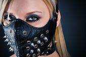 stock photo of sadistic  - portrait of a woman slave in a mask with spikes - JPG