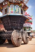 foto of charioteer  - Wooden chariots with flags and paintings of hindu gods in Gokarna city Karnataka India - JPG