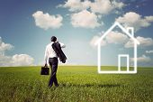 image of going out business sale  - businessman in a suit with a briefcase goes to the house to a spacious green field with a blue sky - JPG