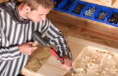 image of gad  - Young carpenter at work in nice workroom - JPG