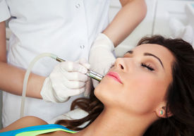 picture of wrinkled face  - Woman getting laser face treatment in medical spa center - JPG