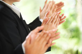 picture of applause  - Businesspeople giving applause over the green environment background - JPG