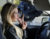 stock photo of unawares  - Woman totally unaware of traffic laws and respect for law enforcement - JPG