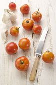 Organic Tomato On An Old Wooden Table