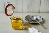 picture of ghee  - clarified liquid ghee butter in glass jar - JPG