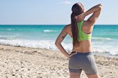 Fit Woman Resting After A Run On The Beach
