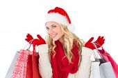 Festive blonde holding shopping bags on white background