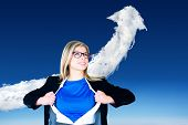 Composite image of businesswoman opening her shirt superhero style against cloud arrow