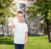 advertising, summer, gesture, people and childhood concept - smiling little boy in white blank t-shi