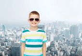 happiness, childhood, dreams and people concept - smiling little boy over green blue cloudy sky back